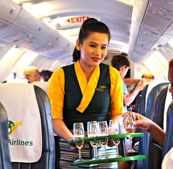 Hostess serving drinks on an Everest Flight