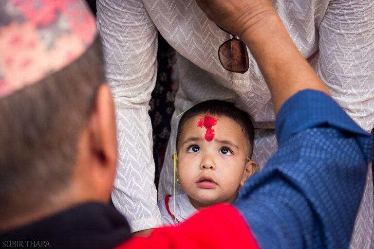 Young boy receiving a tika at Dashain in Nepal