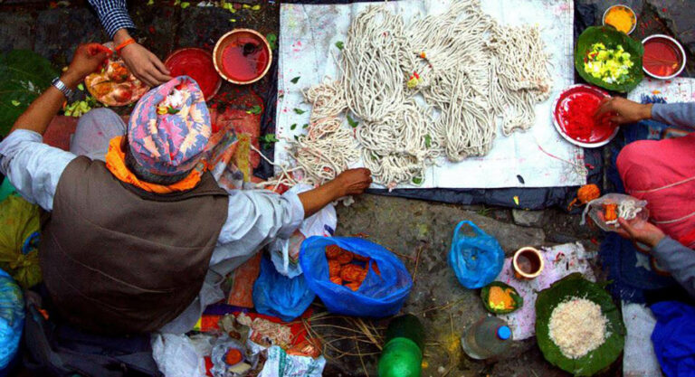 Local man working with threads at Janaipurnima festival in Nepal