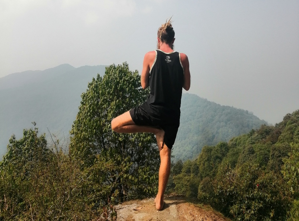 A man practicing outdoor yoga in Nepal